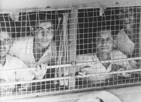 """The British arrested the passengers of the Aliyah Bet (""""illegal"""" immigration) ship """"Parita"""" after they arrived on the Tel Aviv coast and transferred them in caged buses to Atlit detention camp."""