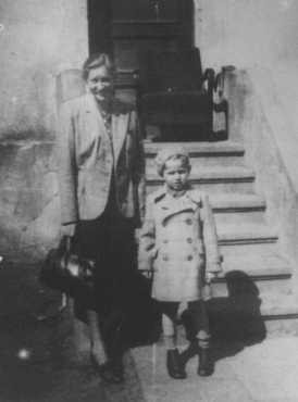 "<p>Gertruda Babilinska with Michael Stolovitzky, a Jewish boy she hid. Yad Vashem recognized her as <a href=""/narrative/11778/en"">Righteous Among the Nations</a>. Vilna, 1943.</p>"
