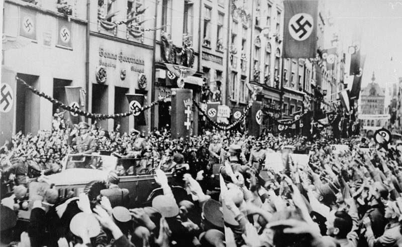 "<p>Saluting Germans greet Adolf Hitler (standing at front of car) as he enters <a href=""/narrative/5616/en"">Danzig</a>. The Danzig District was incorporated into Greater Germany following the <a href=""/narrative/2103/en"">invasion of Poland</a>. Danzig, September 19, 1939.</p>"