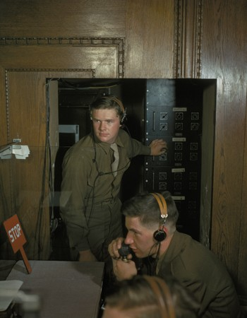 Translators operate an IBM machine during a session of the International Military Tribunal. [LCID: 96314]