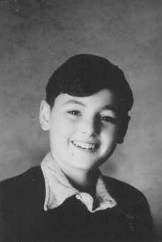 Photo of Peter Feigl, a Jewish child hidden in the Protestant village le Chambon-sur-Lignon. [LCID: 86064]