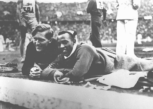 Athletes Jesse Owens of the United States (right) and Lutz Long of Germany at the Olympic stadium. [LCID: 43338]