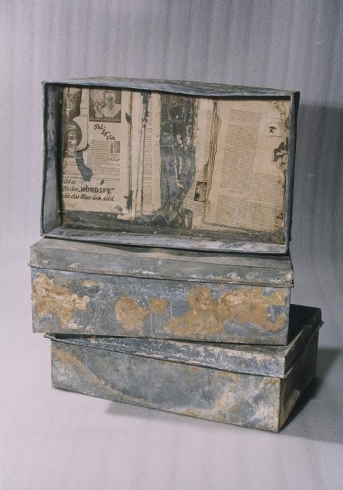 "<p class=""document-desc moreless"">Three of the ten metal boxes in which portions of the Oneg Shabbat archive were hidden and buried in the Warsaw ghetto. The boxes are currently in the possession of the Jewish Historical Institute in Warsaw. In this view the three boxes are stacked on top of one another. The box on top is displayed on its side without the lid.</p>"