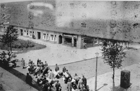 Jews carry luggage to an assembly point before deportation to the Westerbork camp.