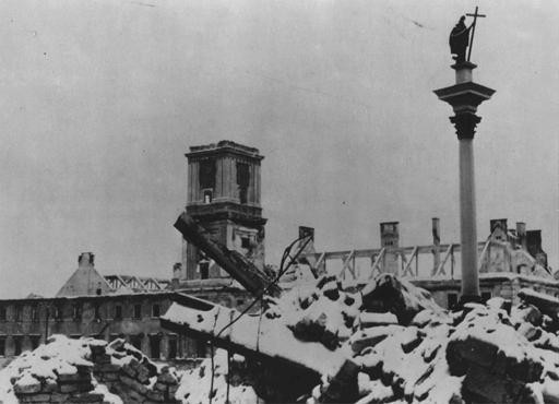 <p>The Sigismund Monument stands amid rubble in the Polish capital after Germany's Blitzkrieg assault. Warsaw, Poland, 1939.</p>