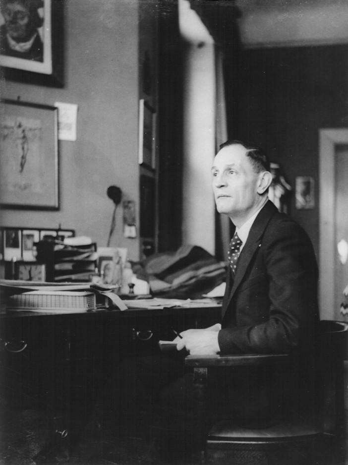 Pastor Martin Niemöller at his desk in his home. [LCID: 63455]