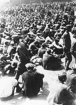 <p>Prisoners in a Nazi-built camp for Soviet prisoners of war. Lida, Poland, 1941.</p>