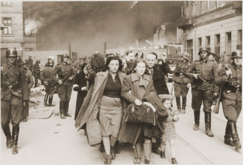 German soldiers lead Jews captured during the Warsaw ghetto uprising to the assembly point for deportation. [LCID: 5472a]