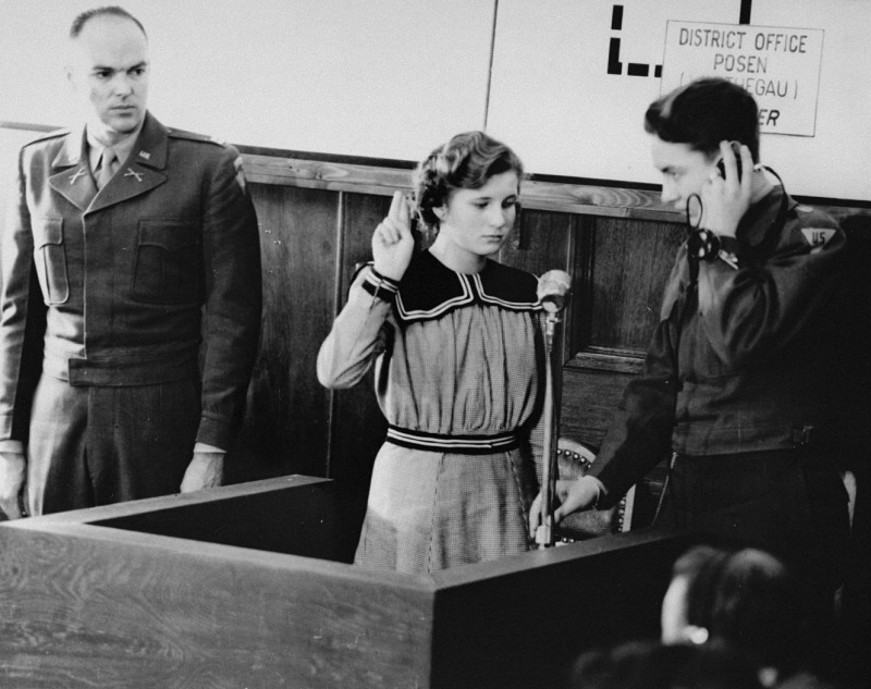 "<p>Fifteen-year-old Maria Dolezalova is sworn in as a prosecution witness at the <a href=""/narrative/9532"">RuSHA Trial</a>. Dolezalova was among the children kidnapped by German forces after they destroyed the town of <a href=""/narrative/39446"">Lidice</a>, Czechoslovakia. Nuremberg, October 30, 1947.</p>"