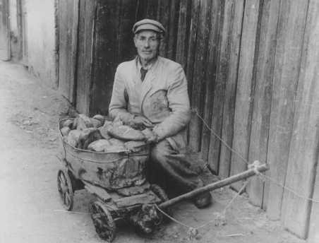 <p>An impoverished ghetto resident sells bread on the black market. Kovno, Lithuania, between 1941 and 1943.</p>