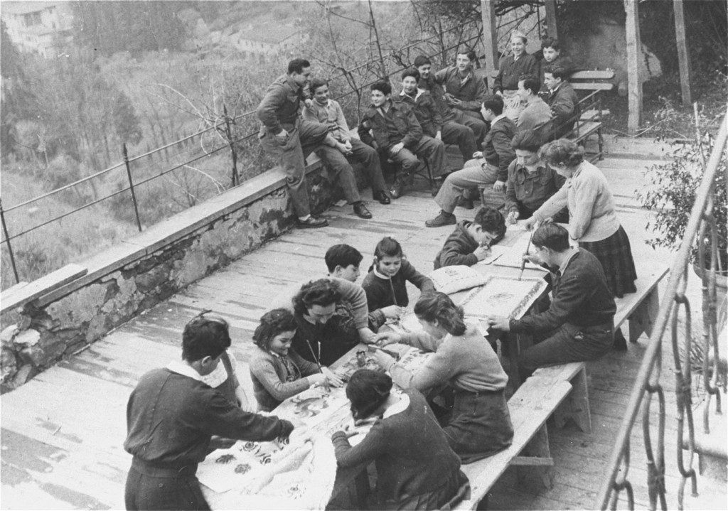 An art class for children in the Fiesole displaced persons camp, outside Florence. [LCID: 69748]