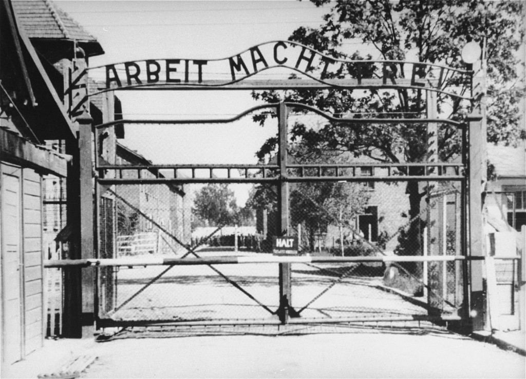 "View of the main entrance to the Auschwitz camp: ""Arbeit Macht Frei"" (Work makes one free). [LCID: 0001]"