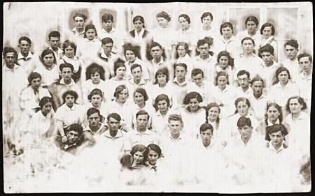 Group portrait of the members of the Zionist pioneer youth group, Ha-Shomer ha-Tsa'ir Hachshara. [LCID: 14397]