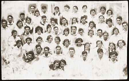 Group portrait of the members of the Zionist pioneer youth group, Ha-Shomer ha-Tsa'ir Hachshara. [LCID: 14397]