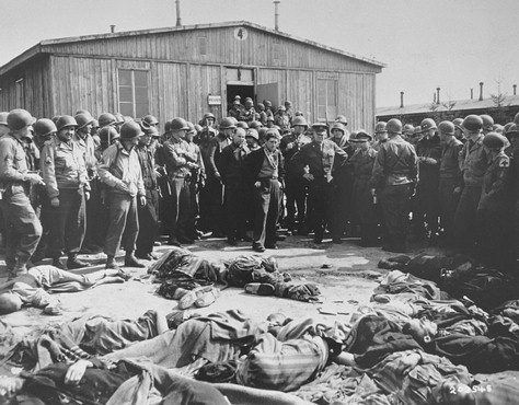 <p>While on a tour of the newly liberated concentration camp, General Dwight Eisenhower and other high-ranking US Army officers view the bodies of prisoners who were killed during the evacuation of Ohrdruf. Ohrdruf, Germany April 12, 1945.</p>