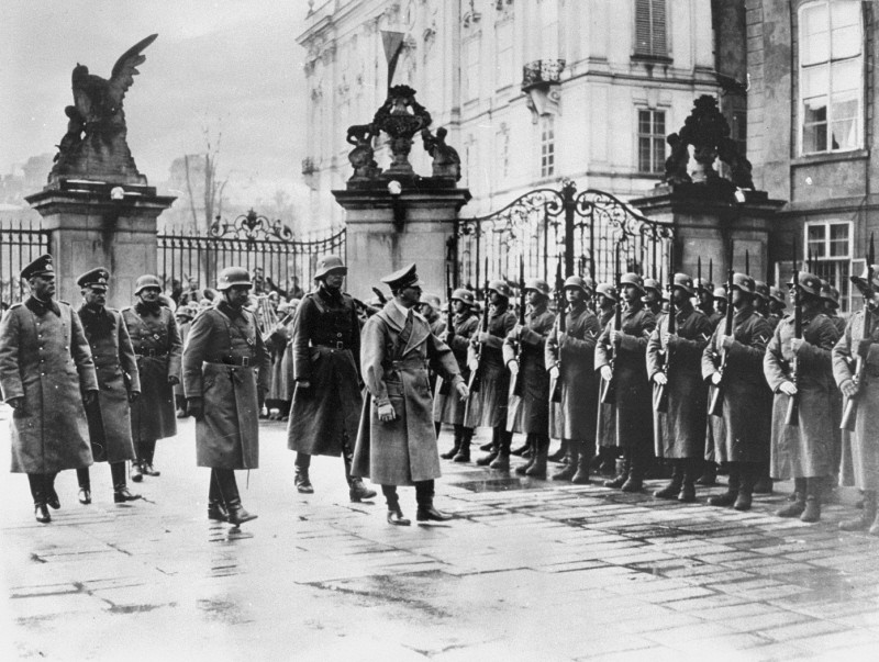 "<p>Adolf Hitler reviews his troops at Prague castle on the day of the occupation. Prague, <a href=""/narrative/7295"">Czechoslovakia</a>, March 15, 1939.</p>"