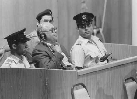 "<p>Defendant <a href=""/narrative/11530"">John Demjanjuk</a> crosses his heart upon hearing the pronouncement of his death sentence. Jerusalem, Israel, April 25, 1988.</p>"
