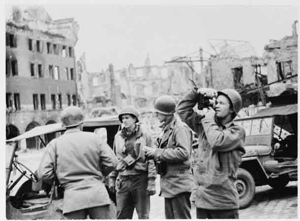 US Army Signal Corps photographers from Combat Unit 123 photograph ruins in the city of Naumburg, Germany. [LCID: 62769]