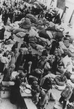<p>Jews deported to the Lodz ghetto. Poland, 1941 or 1942.</p>