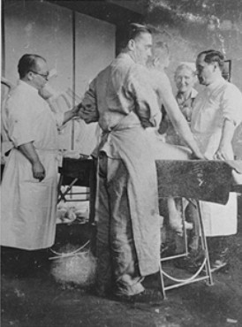 Nazi physician Carl Clauberg (at left), who performed medical experiments on prisoners in Block 10 of the Auschwitz camp. [LCID: 67417]