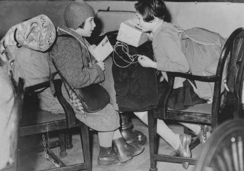 <p>Two Austrian refugee children, part of a group of predominantly Jewish refugee children on a Children's Transport (Kindertransport), upon their arrival in Great Britain. Harwich, Great Britain, December 12, 1938.</p>