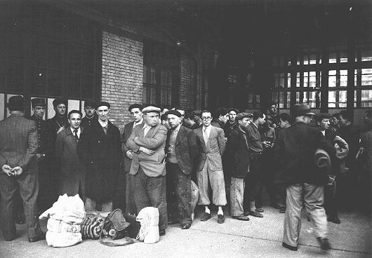 After the first roundup in Paris, French police escort foreign Jewish men from the Japy school to deportation trains at the Austerlitz ... [LCID: 79929]