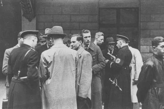 SS and Nazi police prepare for a raid on the Jewish community offices in Vienna. [LCID: 65636a]