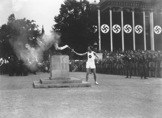 "<p>The last of the 3,000 runners who carried the Olympic torch from Greece lights the Olympic Flame in Berlin to start the 11th <a href=""/narrative/7139/en"">Summer Olympic Games</a>. Berlin, Germany, August 1936.</p>"