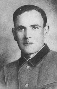 Postwar portrait of Alexander Bielski, a founding member of the Bielski partisan group. [LCID: 12135]