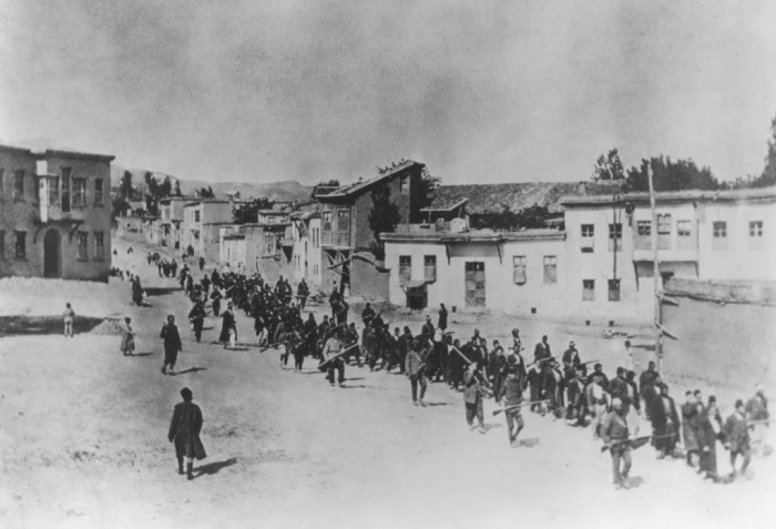 <p>Ottoman military forces march Armenian men from Kharput to an execution site outside the city. Kharput, Ottoman Empire, March 1915-June 1915. [Courtesy of the Armenian National Institute.]</p>