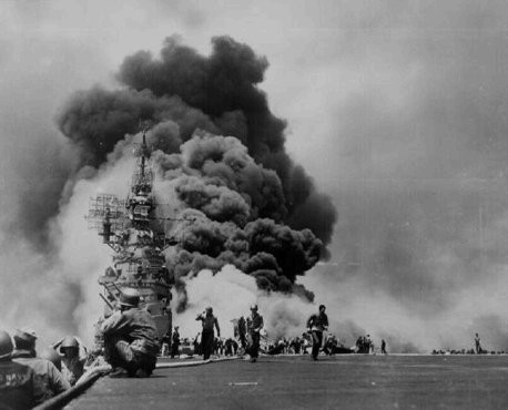<p>US sailors struggle to contain damage from Kamikaze attacks during the US invasion of Okinawa, the largest of the Ryukyu Islands (the islands closest to the Japanese home islands). May 11, 1945.</p>