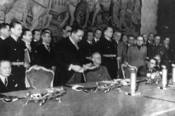 Bulgarian leader Bogdan Filov (standing) and German foreign minister Joachim von Ribbentrop (seated, center) during the signing of ... [LCID: tl118]