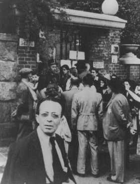 Hungarian Jews wait in front of the Swedish legation main office in hopes of obtaining Swedish protective passes. [LCID: 74025]