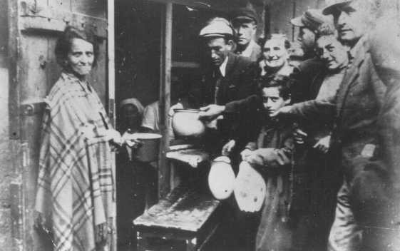 <p>Poverty in the ghetto: residents wait for soup at a public kitchen. Lodz ghetto, Poland, between 1940 and 1944.</p>