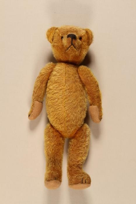 Teddy bear carried by a young boy on a Kindertransport
