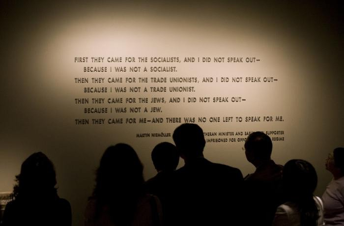 Quotation from Martin Niemöller on display in the Permanent Exhibition of the United States Holocaust Memorial Museum, with visitors