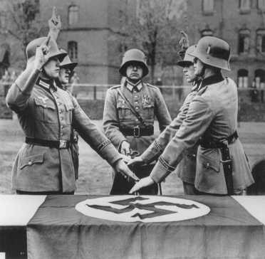<p>Members of a German military unit swear allegiance to Adolf Hitler. Germany, date uncertain.</p>