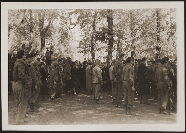 "<p>After the liberation of the <a href=""/narrative/7988"">Wöbbelin</a> camp, US troops forced the townspeople of Ludwigslust to bury the bodies of prisoners killed in the camp. This photo shows US troops assembled at the mass funeral in Ludwigslust. Germany, May 7, 1945.</p>"