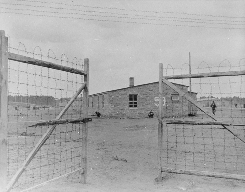 "<p>The main gate of the <a href=""/narrative/7988"">Wöbbelin</a> concentration camp. On May 2, 1945, the <a href=""/narrative/7926"">8th Infantry Division</a> and the <a href=""/narrative/7977"">82nd Airborne Division</a> encountered the Wöbbelin concentration camp. Photograph taken upon the liberation of the camp by US forces. Germany, May 4, 1945.</p>"