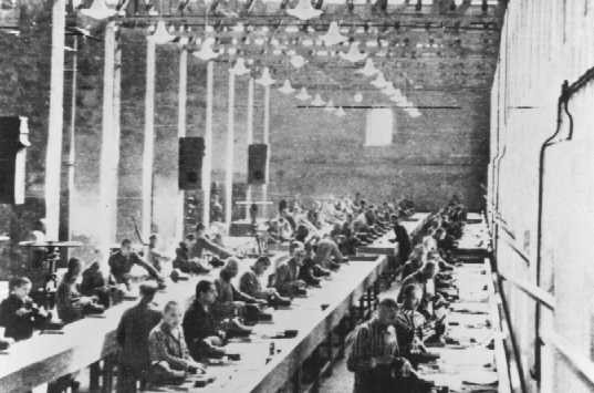 <p>Prisoners at forced labor in the Siemens factory. Auschwitz camp, Poland, 1940–44.</p>