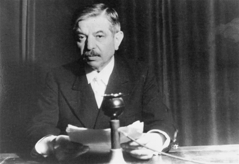 "<p>Pierre Laval, head of the government of Vichy France and Nazi collaborator. Shown here delivering a radio address. <a href=""/narrative/4997/en"">France</a>, 1941–42.</p>"