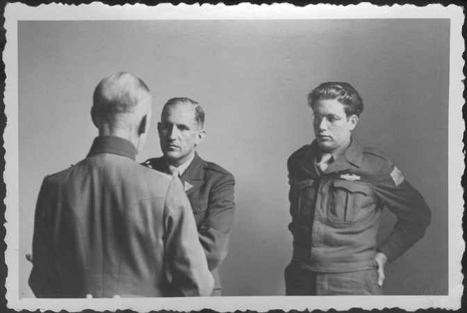 German Field Marshal Gerd von Rundstedt (with his back to the camera) speaks to American prosecutor Robert Kempner (left) and interpreter Gerald Schwab during a pause at the IMT Nuremberg commission hearings investigating the Supreme Command of the German Armed Forces.