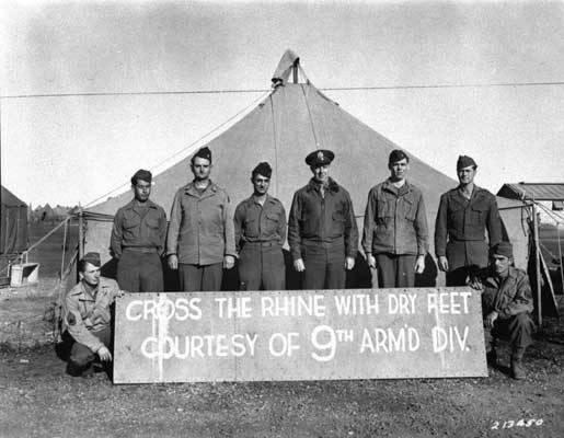 The commanding general of the 9th Armored Division (third from right), and members of the division who won the Distinguished Service ... [LCID: sc250]