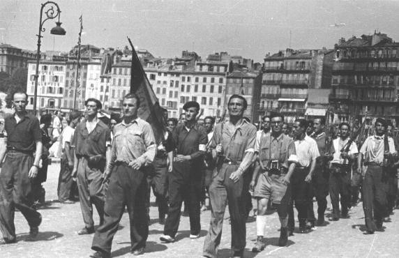 <p>An emigre section of the French resistance marches through Marseille after the city's liberation. Marseille, France, August 29, 1944.</p>