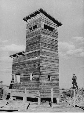 Ustasa (Croatian fascist) guard next to a watchtower at the Jasenovac concentration camp. [LCID: 90179]