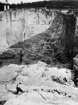 "<p>View of the stone quarry in the <a href=""/narrative/6074/en"">Gross-Rosen</a> camp, where prisoners were subjected to forced labor. Gross-Rosen, Germany, 1940-1945.</p>"