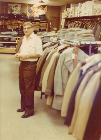 <p>Aron standing in Howard's men's clothing store (named for his eldest son) at 9125 Commercial Avenue in Chicago. He opened the store in 1949 and owned it for 30 years. Chicago, Illinois, early 1970s.</p>