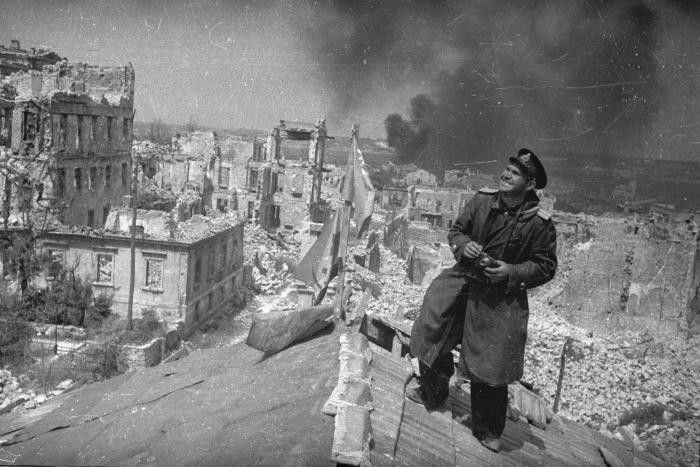 """<p><span style=""""font-weight: 400;"""">Soviet photographer Yevgeny Khaldei views the destruction of Budapest from a rooftop. Budapest, Hungary,</span><span style=""""font-weight: 400;"""">February 1945.</span></p>"""