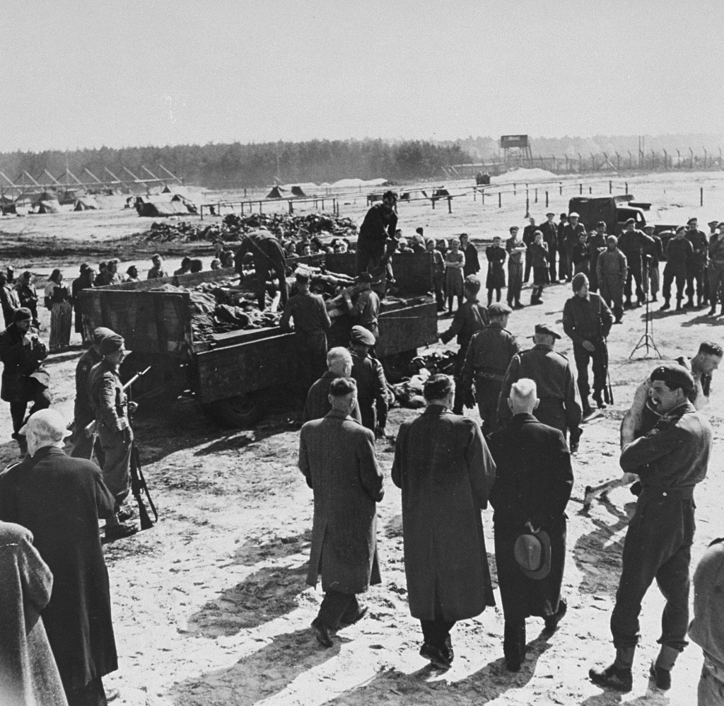 After liberation of the Bergen-Belsen camp, British soldiers forced German mayors from nearby towns to view mass graves. [LCID: 74938]