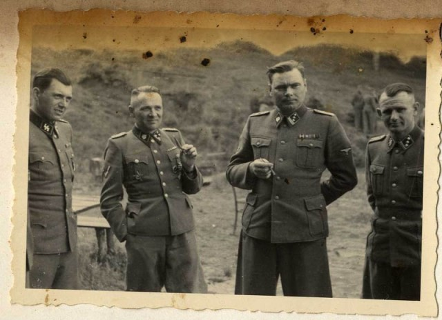 <p>A group of SS officers socialize at an SS retreat outside Auschwitz. Pictured from left to right: Dr. Josef Mengele, Rudolf Höss, Josef Kramer, and an unidentified officer.</p>